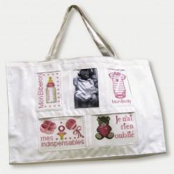 white baby bag